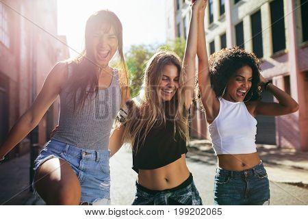 Three Beautiful Girls Walking Around The City And Having Fun