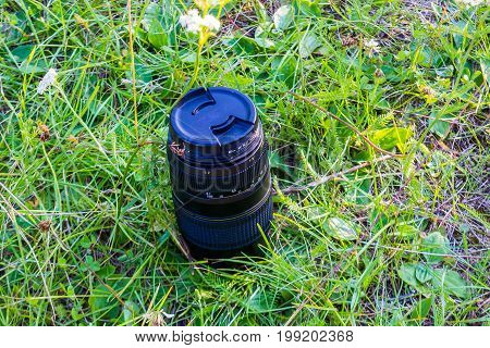 A Telephoto Lens Standing In Green Grass