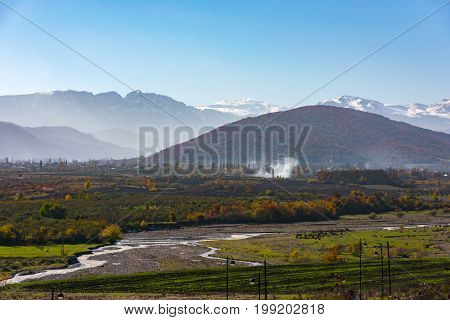Beautiful autumn rural landscape. View of the foothill village