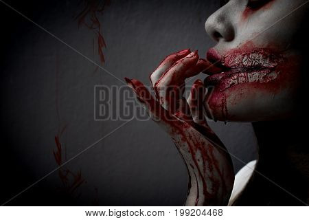 Zombie women death the ghost drain hand blood skin is screaming darkness and nightmare background horror of scary fear on hell is monster devil girl in halloween festival concept copy space the left.
