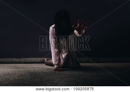 Zombie women death ghost with blood darkness background horror halloween festival concept