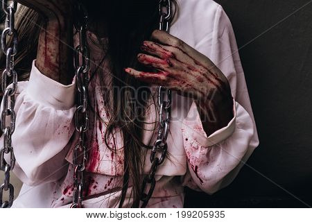 Zombie women death ghost standing with blood and chain darkness background horror halloween festival concept