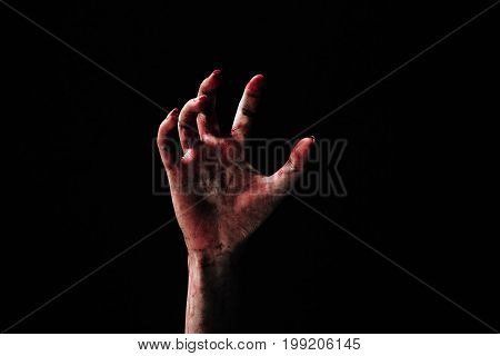 Hand zombie death with blood touching stair on nightmare darkness background horror halloween festival concept
