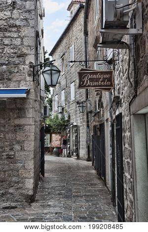 BUDVA MONTENEGRO - JUNE 30 2017: Narrow streets of the old city of Budva always attract tourists