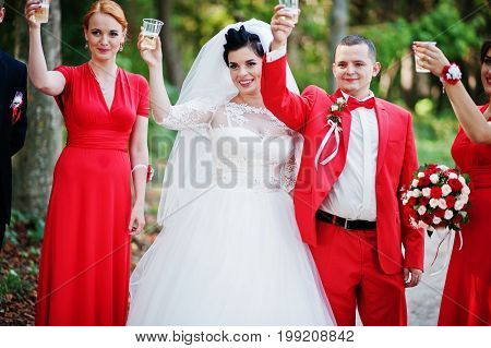 Wedding Couple And Groomsmen With Bridesmaids Drinking Champagne In The Forest.