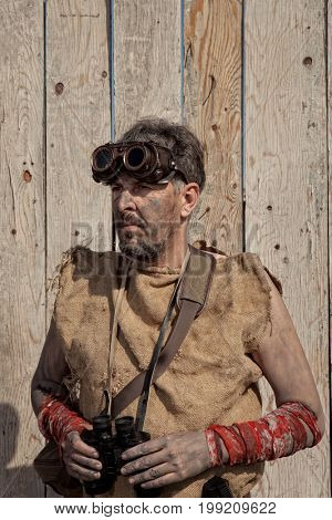 Vintage steampunk man wearing glasses with binoculars