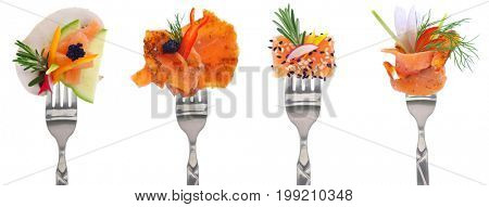 Variety of smoked salmon bites on forks - white background