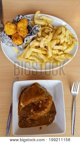 Chicken Nuggets with french fries and jacked potato