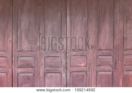 Old wooden folding door texture for use as background.