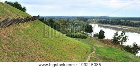 Rural countryside view of farmland landscape with tidal river green hills