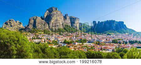 Kalampaka town with Metora cliffs and monastery Greece.