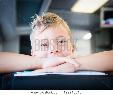 Cute little boy on the train looking at the camera