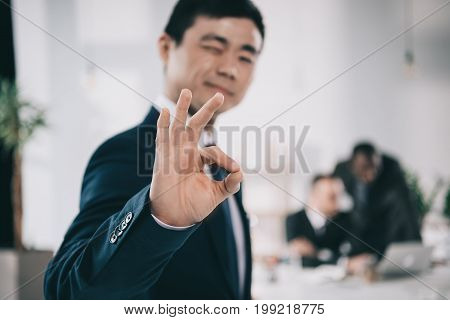 Successful Handsome Asian Businessman Showing Okay Sign