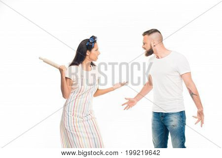 'angry Housewife With Rolling Pin Having Conflict With Husband, Isolated On White