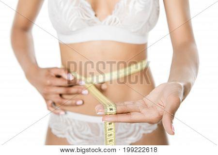Woman Measuring Waistline With Measuring Tape