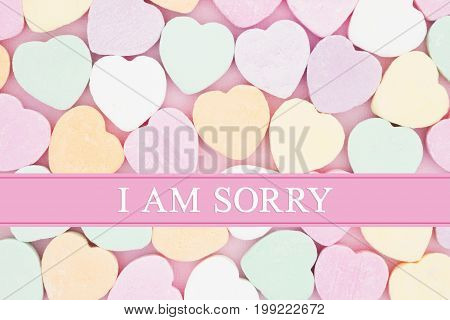 Retro apology message Retro heart shaped candy on pick fabric with text I am sorry