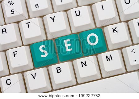 Search engine optimization on the Internet A close-up of a keyboard with teal highlighted text SEO 3D Illustration