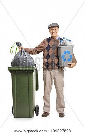 Full length portrait of a senior with a recycling bin throwing a garbage bag in a trash can isolated on white background