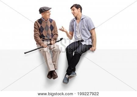 Senior and a young man sitting on a panel and talking isolated on white background