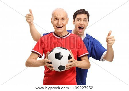 Senior in a jersey holding a football with a young man behind him holding his thumbs up isolated on white background