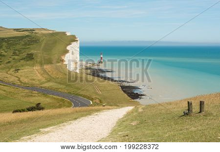 The lighthouse and white chalk cliffs at Beachy Head near Eastbourne East Sussex England
