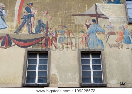 BERN, SWITZERLAND - FEBRUARY 23, 2012: Exterior of the fresco at the medieval building wall in Bern, Switzerland.