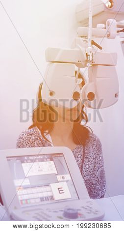 Asian Woman Test Eyesight With Professional Optometrist For Glasses
