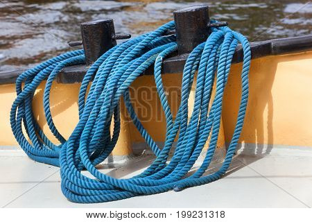 Bollards and a blue rope on a ship