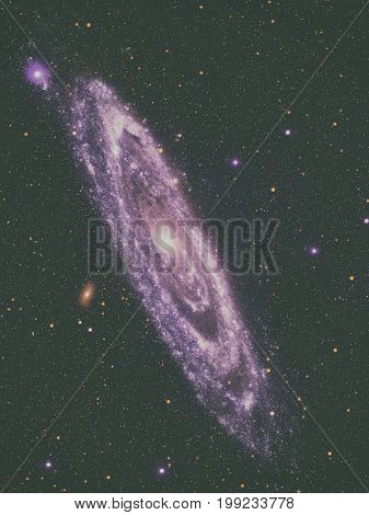 The Andromeda Galaxy, Messier 31 or M31 is a spiral galaxy in the constellation of Andromeda. It is the nearest major galaxy to the Milky Way. Retouched image. Elements of this image furnished by NASA