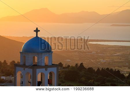 Sunset view with church belfry from Asfendiou village in Kos island Greece