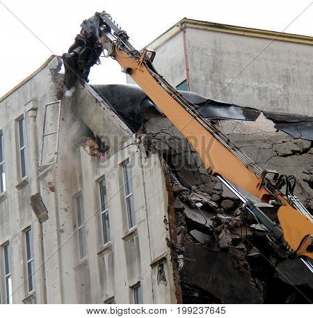 Debris Falling as a Tall Building is Demolished.