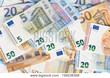 European union currency euro banknotes bills background. 2 10 20 and 50 euro. Concept success rich economy. On white background Europe