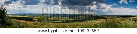 Panorama of the steppe Donbass opening with the Saur grave