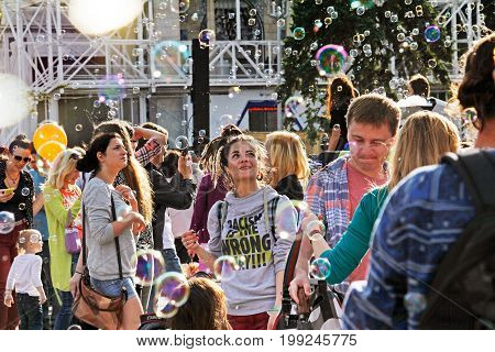 Moscow Russia - August 01 2015: Young woman looking at soap bubbles at the festival