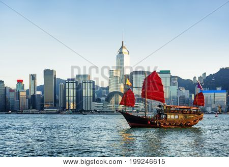 Traditional Chinese Sailing Ship In Rays Of Setting Sun