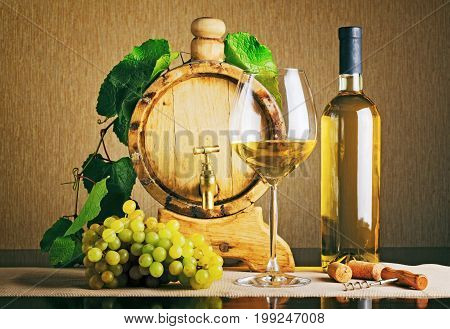 Wooden Wine Barrel With Grape Twig. Bottle Of White Wine