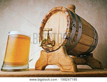 Bottom View Of Wooden Beer Keg And Mug Of Beer