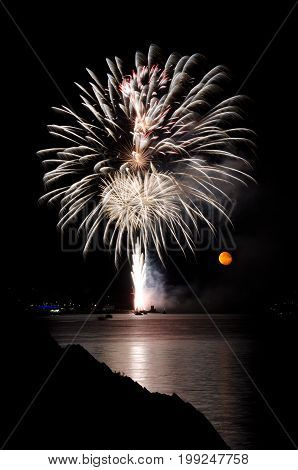PLYMOUTH, ENGLAND. 10th August 2017. The moon rises during the British Firework Championships, a huge firework competition held annually in Britain's Ocean City.