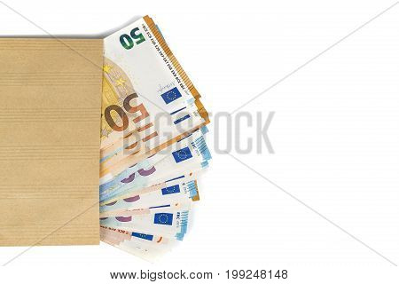 Brown envelope full of euro banknotes bills onwhite background. Concept of corruption and bribery