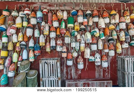 Old and worn out mooring buoys hanged on a wall.