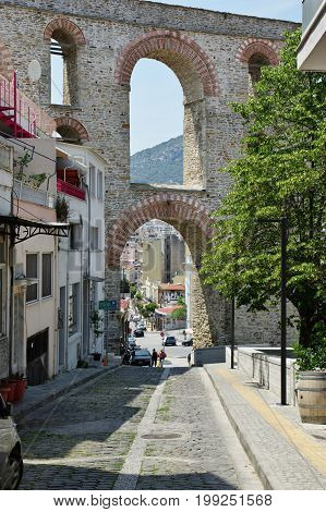 Kavala Greece - June 16 2017: city in northern Greece in the Macedonia-Thrace region located on the Aegean Sea.The road leading to the Byzantine citadel located on the hill. In the background you can see a Roman aqueduct from the 16th century.