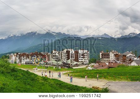 Tourists Take Pictures Of Sights Of The Ski Resort