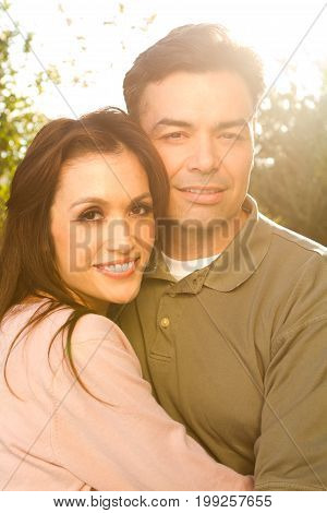 Cute happy Hispanic couple laughing and smiling.