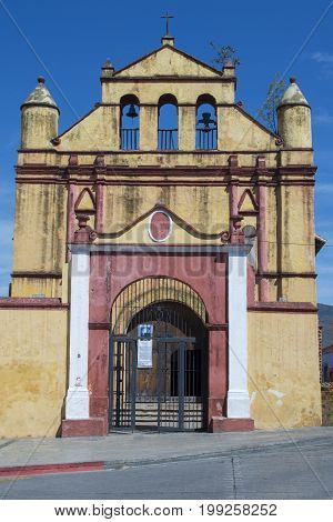 Colorul yellow facade of San Nicolas Catholic church in San Cristobal de las Casas Chiapas Mexico on sunny day