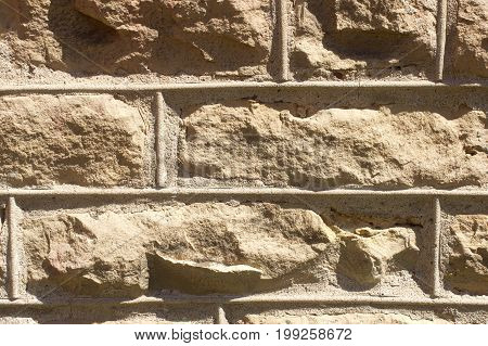 A closeup view of a stone wall for background use.