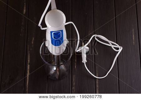 hand blender electric mixer on the black background