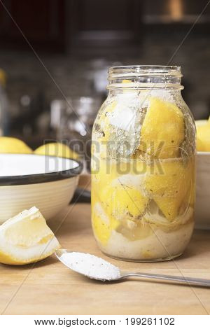 The Process of making salted preserved lemons by cutting and spicing