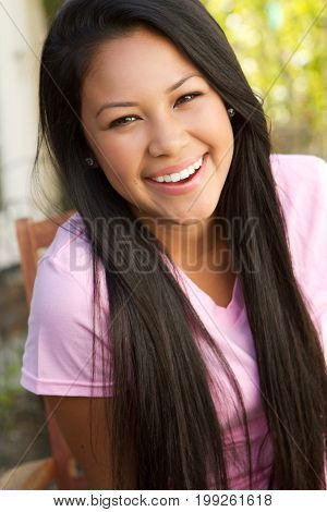 Portrait of a young teenage girl smiling.