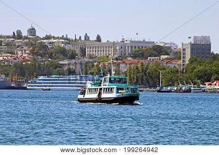 SEVASTOPIL, UKRAINE - JUNE 22, 2010: Touristic boat in Sevastopol bay in Crimea, Ukraine