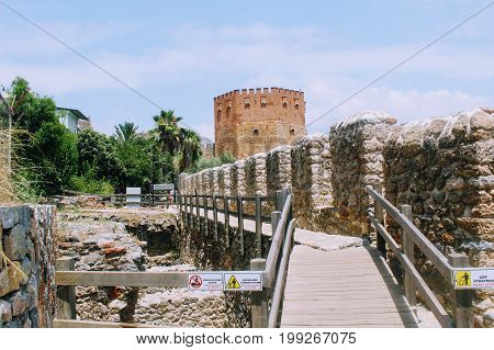 View of Red Tower and fortress wall from the old shipyard (Alanya, Turkey).